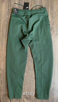 Nike Sportswear Woven Tech Pants Men's Sz Small S Galactic Jade Green AR3221-370